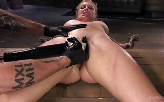 Pleasure and pain for 	submissive Cherie DeVille close by a Dom's dungeon