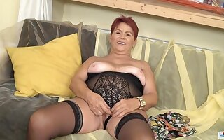 Red haired, Czech granny is wearing erotic, black lingerie and playing with a sex kickshaw