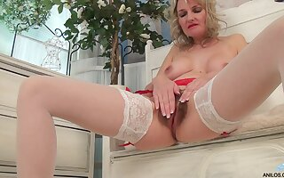 Foxy blonde mature Roxy Jay opens her legs to finger her hairy cunt