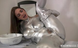 Naked beauty covers herself in silver paint of a kinky solo