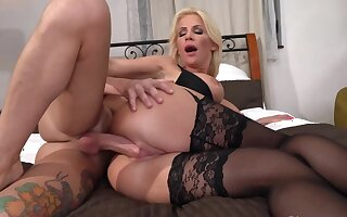 MILF in stockings and bra has coitus involving a perky guy