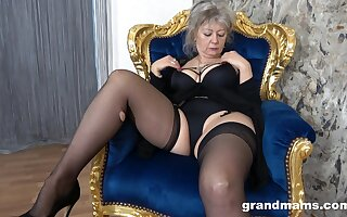 Dirty granny in black lingerie increased by stockings moans while playing