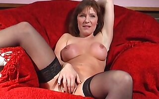 Mature old bag Wendy Taylor opens her legs to drill her lady-love hole