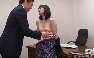 Provocative Asian amanuensis bends over the table to be fucked