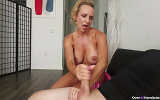 Blonde mature wants some sperm on those fine melons