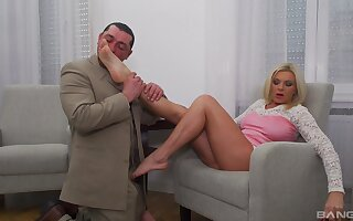 Mature gets her dose in a restless XXX couch shag