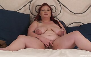 Solo mature redhead drops her clothes to pleasure her juicy pussy