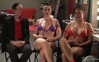 Busty babe Ariel X gets dominated by strong woman Mistress Kara