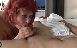 Red haired, American mature in menacing stockings likes to have casual dealings with younger guys