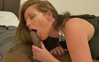 Holly Kiss and a handsome, black man are fucking in front of a proximate camera