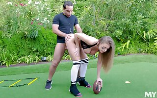 Football fanatic Britney Amber sheds protective gear at hand fuck outside
