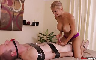 Unobscured and slutty masseuse subjects consumer to bondage and teasing handjob