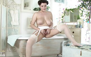 Big titted brunette in glum stockings and garter gang is state of affairs up in the Babytalk do number two