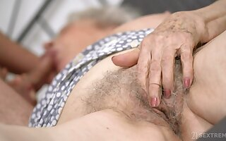 Unfit granny with big boobs Norma B gets intimate with young supplicant