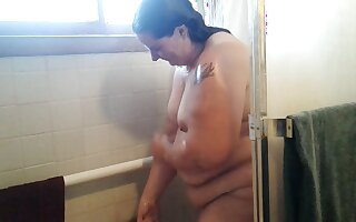 This BBW slut loves to take a shower in turn of the camera