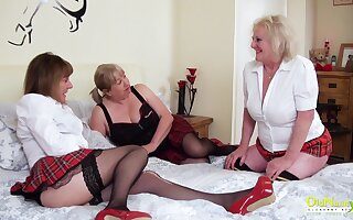 Three extremely horny mature lesbians captured while pussy licking and playing with sex toys