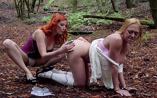 Dee Williams submits to Maitresse Madeline Marlowe during outdoor Lezdom